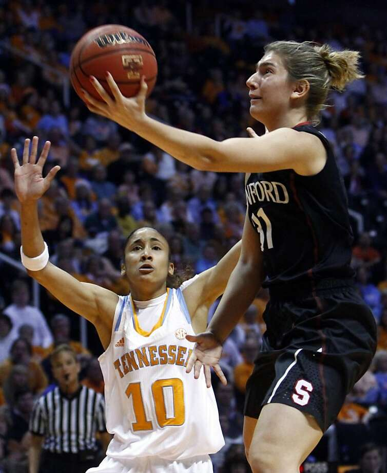 Stanford guard Toni Kokenis (31) puts a shot up past Tennessee guard Meighan Simmons (10) in the first half of an NCAA college basketball game on Saturday, Dec. 22, 2012, in Knoxville, Tenn. Stanford won 73-60.  (AP Photo/Wade Payne) Photo: Wade Payne, Associated Press