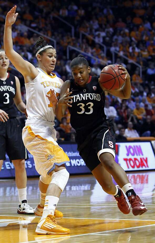 Stanford guard Amber Orrange (33) drives past Tennessee forward Taber Spani (13) in the first half of an NCAA college basketball game on Saturday, Dec. 22, 2012, in Knoxville, Tenn. Stanford won 73-60.  (AP Photo/Wade Payne) Photo: Wade Payne, Associated Press