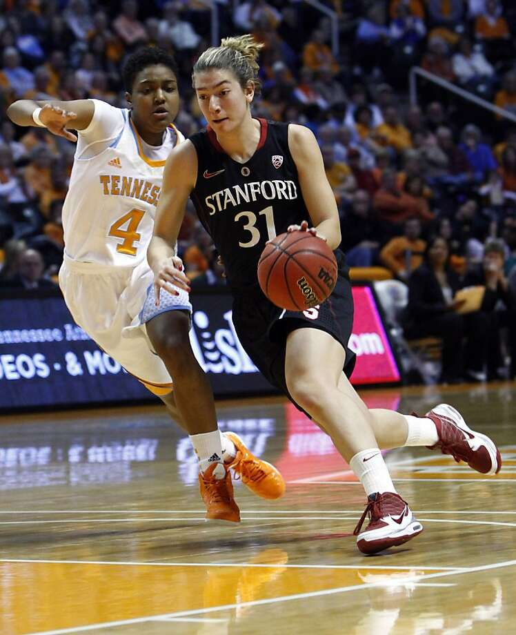 Stanford guard Toni Kokenis (31) drives against Tennessee guard Kamiko Williams (4) in the first half of an NCAA college basketball game on Saturday, Dec. 22, 2012, in Knoxville, Tenn. Stanford won 73-60. (AP Photo/Wade Payne) Photo: Wade Payne, Associated Press