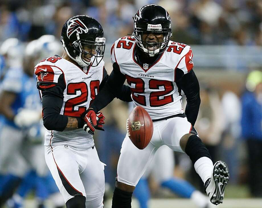 DETROIT, MI - DECEMBER 22:  Asante Samuel #22 of the Atlanta Falcons reacts after a fourth quarter interception next to Thomas DeCoud #28 while playing the Detroit Lions at Ford Field on December 22, 2012 in Detroit, Michigan. Atlanta won the game 31-18. (Photo by Gregory Shamus/Getty Images) Photo: Gregory Shamus, Getty Images
