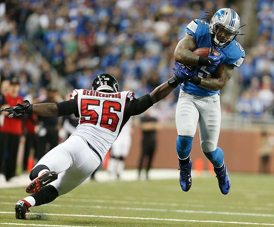DETROIT, MI - DECEMBER 22:  Mikel Leshoure #25 of the Detroit Lions tries to get around the tackle of Sean Weatherspoon #56 of the Atlanta Falcons at Ford Field on December 22, 2012 in Detroit, Michigan. Atlanta won the game 31-18. (Photo by Gregory Shamus/Getty Images) Photo: Gregory Shamus, Getty Images