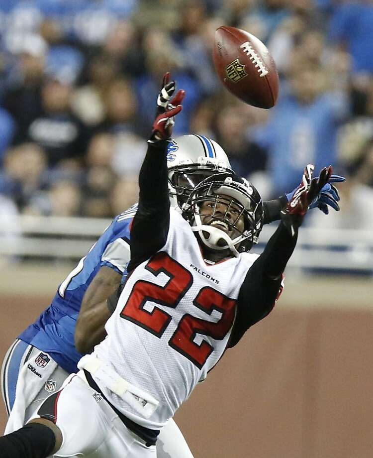 Atlanta Falcons cornerback Asante Samuel (22) intercepts a pass intended for Detroit Lions wide receiver Calvin Johnson, rear, during the fourth quarter of an NFL football game at Ford Field in Detroit, Saturday, Dec. 22, 2012. (AP Photo/Duane Burleson) Photo: Duane Burleson, Associated Press