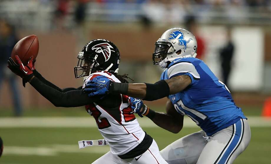 DETROIT, MI - DECEMBER 22:  Asante Samuel #22 of the Atlanta Falcons interceps Matthew Stafford #9 of the Detroit Lions as Calvin Johnson #81 makes the stop during the fourth quarter at Ford Field on December 22, 2012 in Detroit, Michigan. The Falcons defeated the Lions  31-18.  (Photo by Leon Halip/Getty Images) Photo: Leon Halip, Getty Images