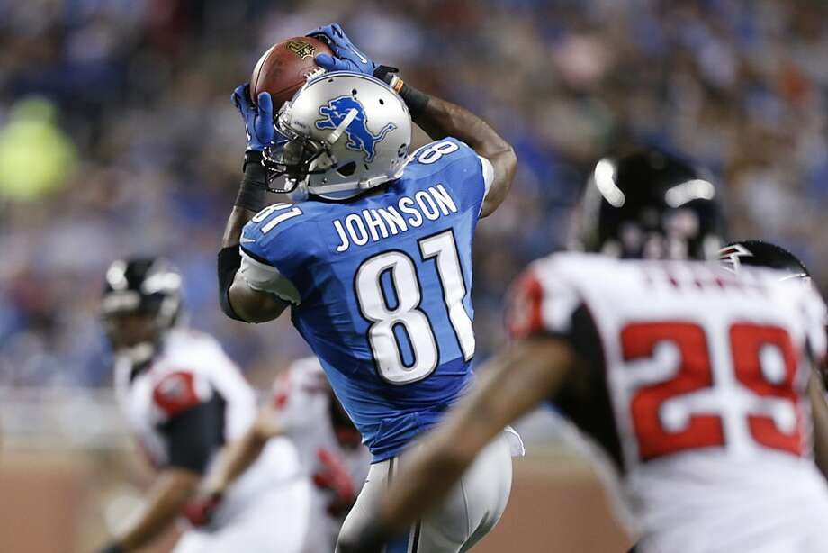 Detroit Lions wide receiver Calvin Johnson (81) makes a reception during the third quarter of an NFL football game against the Atlanta Falcons at Ford Field in Detroit, Saturday, Dec. 22, 2012. (AP Photo/Rick Osentoski) Photo: Rick Osentoski, Associated Press