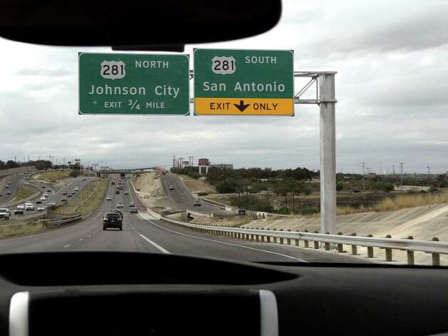 A sign announces the offramps to US 281 North and South from Loop 1604 West on Saturday, Dec. 22, 2012. The ramps just opened. Photo: Billy Calzada, San Antonio Express-News / SAN ANTONIO EXPRESS-NEWS