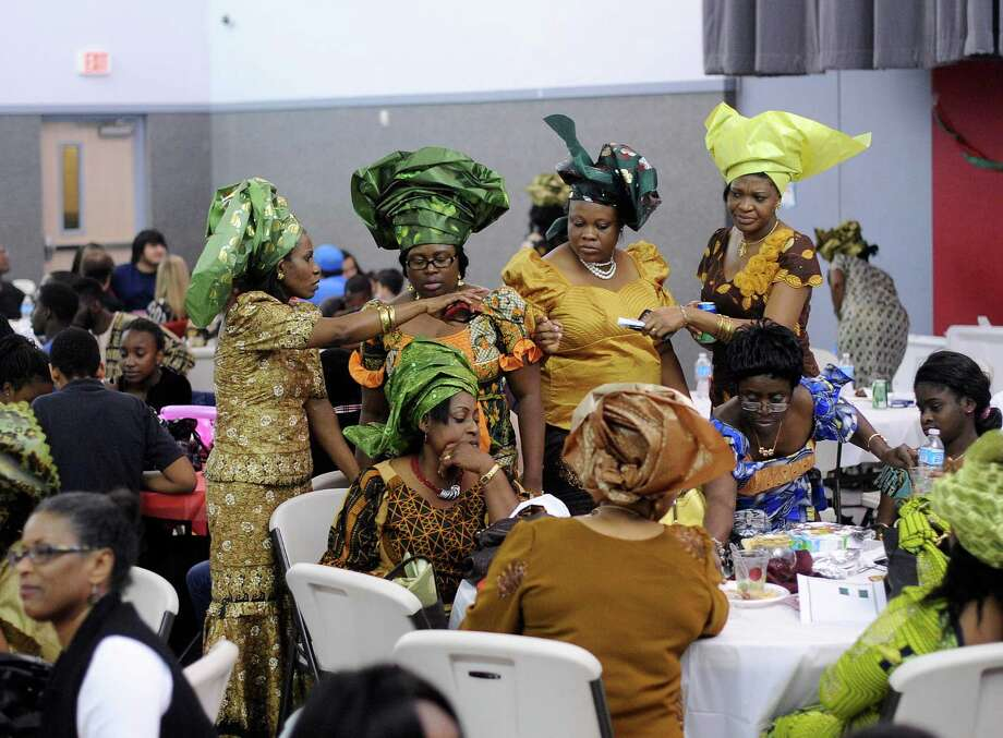 People attend the annual Christmas party for Nigerian children of San Antonio at St. Matthew Catholic Church on Saturday night, Dec. 22, 2012. The event is sponsored by professional Nigerian immigrant women. Photo: Billy Calzada, San Antonio Express-News / SAN ANTONIO EXPRESS-NEWS