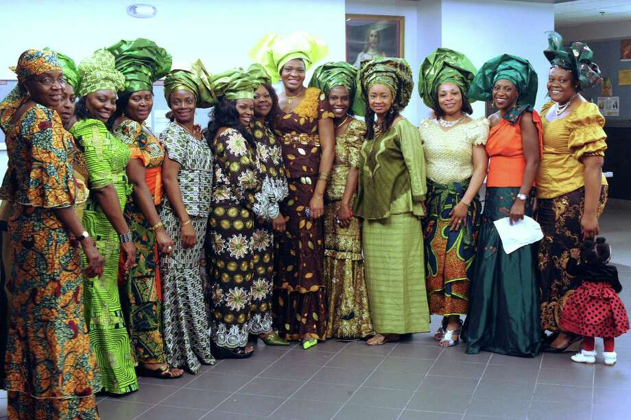 Women of the Nigerian community of San Antonio attend the annual Christmas party for Nigerian children of San Antonio at St. Matthew Catholic Church on Saturday night, Dec. 22, 2012. Photo: Billy Calzada, San Antonio Express-News / SAN ANTONIO EXPRESS-NEWS