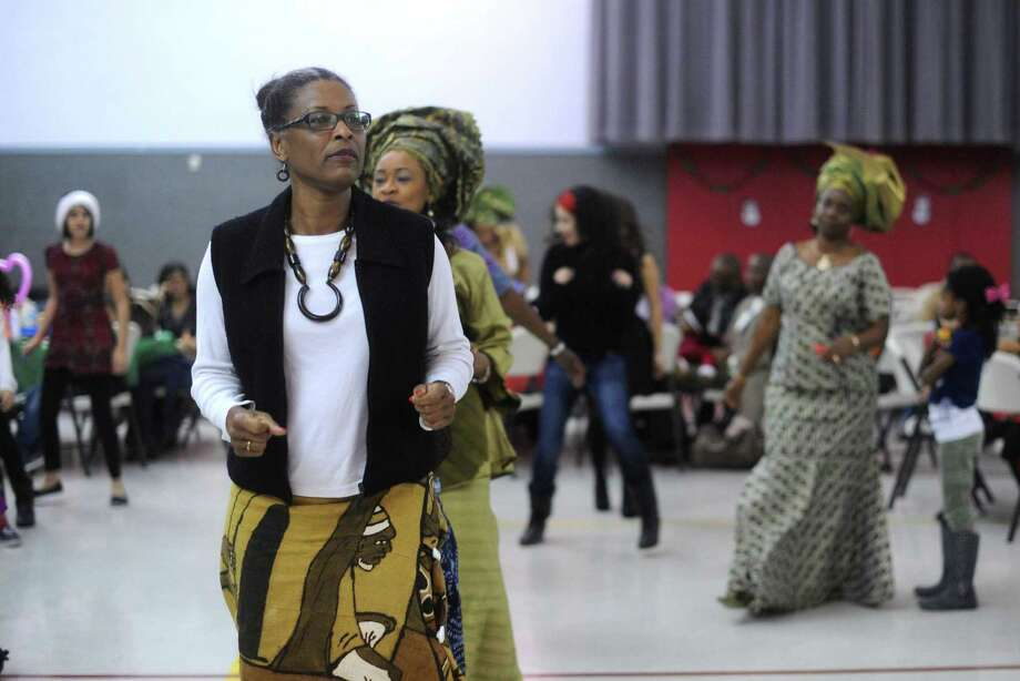 People dance during the annual Christmas party for Nigerian children of San Antonio at St. Matthew Catholic Church on Saturday night, Dec. 22, 2012. Photo: Billy Calzada, San Antonio Express-News / SAN ANTONIO EXPRESS-NEWS