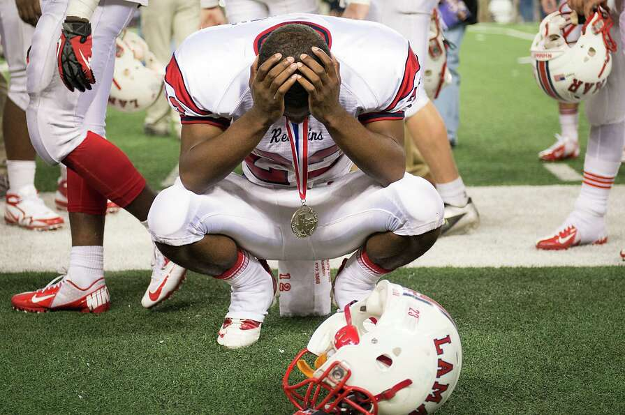 Lamar defensive back Darielle Smith (23) reacts after receiving his state runner up medal after the