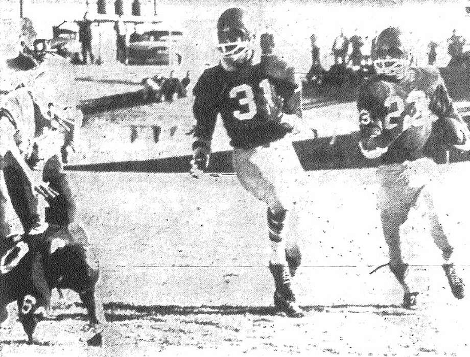Brackenridge's Pete Bautista (right) has teammate Floyd Boone (31) blocking in front of him as Bautista returns a kickoff against Borger. File photo
