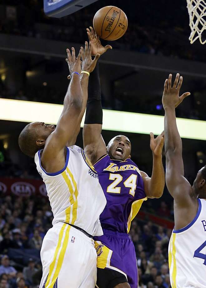 The Warriors' Carl Landry (left) contests a shot by Kobe Bryant. Photo: Marcio Jose Sanchez, Associated Press