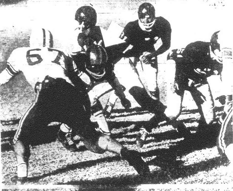 Brackenridge's Warren McVea (center) is momentarily stopped by Borger's John LaGrone (67) but pushes across the goal line for the winning touchdown. File photo