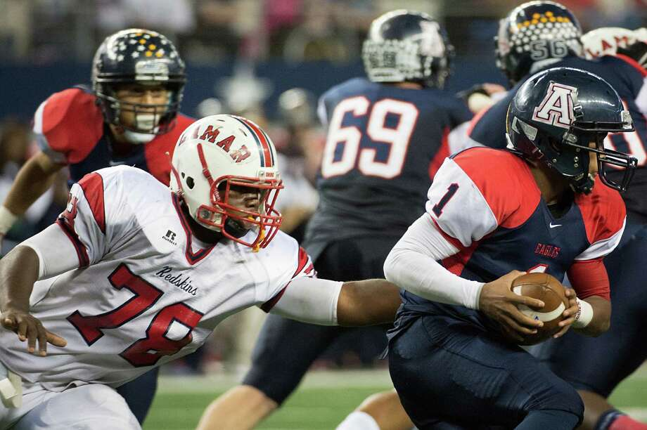 Allen quarterback Kyler Murray (1) slips away from Lamar defensive lineman Ira Lewis (78) during the first half of the Class 5A Division I state championship game Saturday night at Cowboys Stadium. Photo: Smiley N. Pool, Staff / © 2012  Houston Chronicle