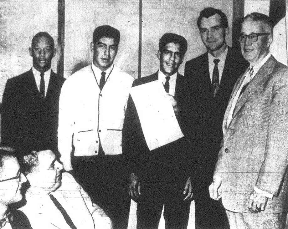 The Brackenridge 1962 football team is honored: (from left) Robert Wade, Isidro Villalobos, Victor Castillo, assistant coach Herman Humble and San Antonio Mayor McAllister.