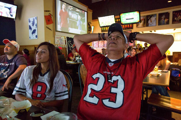 Oved Carranza of the Houston Texans Fan Club of San Antonio reacts to a call going against the Texans during a Texans game against the Tennessee Titans at Buffalo Wild Wings Grill & Bar at 5860 De Zavala Road on Sunday, Dec. 2, 2012. Carranza has supported the Texans since their first season in 2002. Photo: Michael Miller, For The Express-News / © San Antonio Express-News