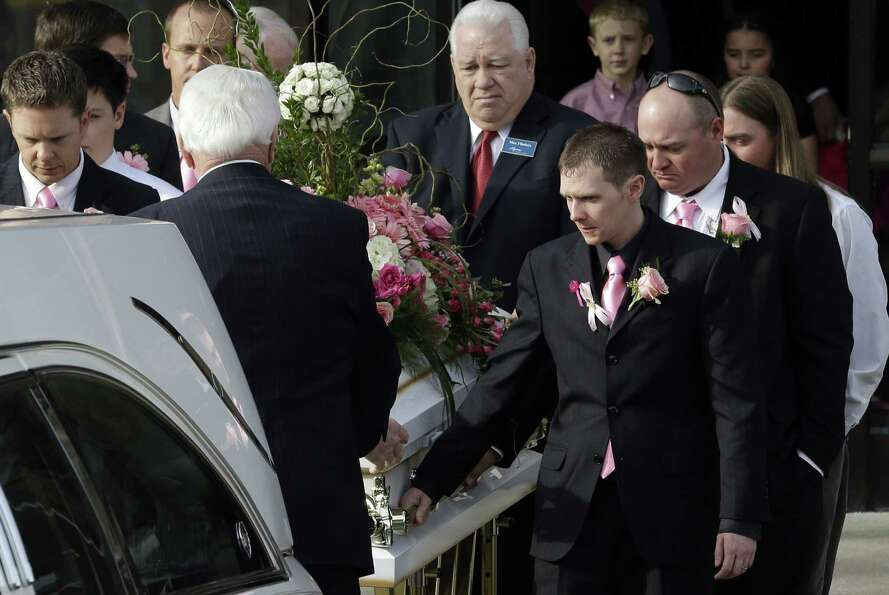 The casket of 6-year-old Emilie Parker is carried following funeral services on Saturday, Dec. 22, 2