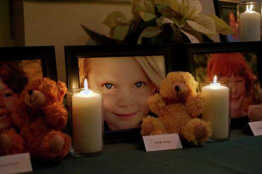 A candle is lit for Emilie Parker during a vigil in Pearland, Texas Friday, Dec. 21, 2012. Photo: Kirk Sides, (AP Photo/The Courier, Kirk Sides) / Associated Press