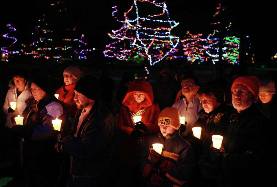 Casper residents hold candles Friday evening, Dec. 21, 2012 during a vigil for the 27 victims of the Newtown, Conn. shootings at Conwell Park in Casper, Wyo. Organizers gathered people together on the longest night of the year to symbolize an emergence from the darkness of the violence. The vigil was one of several local observances for the Newtown victims that took place Friday. Photo: Alan Rogers, AP Photo/The Casper Star-Tribune, Alan Rogers / Associated Press