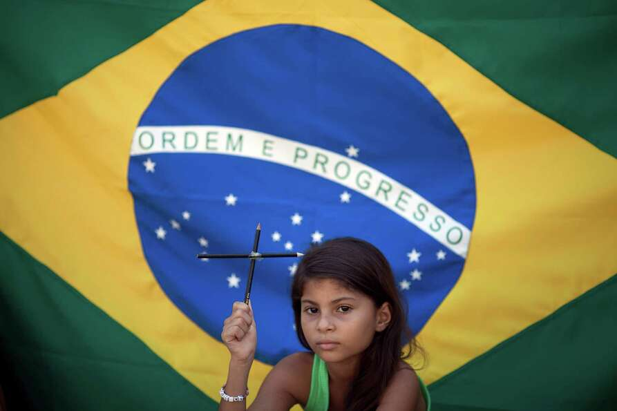Larissa Vitoria, 7, who lives across the street from the Tasso da Silveira school where 12 children