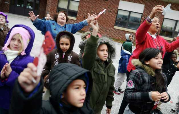 First graders look up into the sky after releasing 26 balloons into the sky in memory of those who were killed in the shooting at Sandy Hook Elementary school at Devers Elementary School in York, Friday, Dec. 21, 2012 in York, Pa. Photo: KATE PENN, AP Photo/York Daily Record, Kate Penn / Associated Press