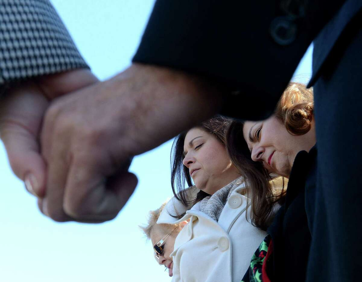 People participate in a remembrance ceremony for victims of the Sandy Hook Elementary School shooting, Friday, Dec. 21, 2012, at the Capitol in Montgomery, Ala.