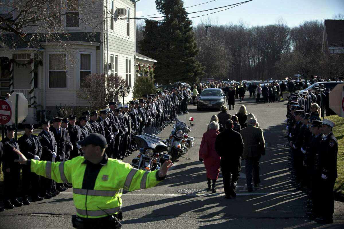 NEWTOWN, CT - DECEMBER 19: Mourners enter St. Rose of Lima Church for the funeral of Charlotte Bacon, 6, December 19, 2012 in Newtown, Connecticut. Six victims of the Newtown school shooting are being honored at funerals and visitations across the state today for the victims of Sandy Hook Elementary School.