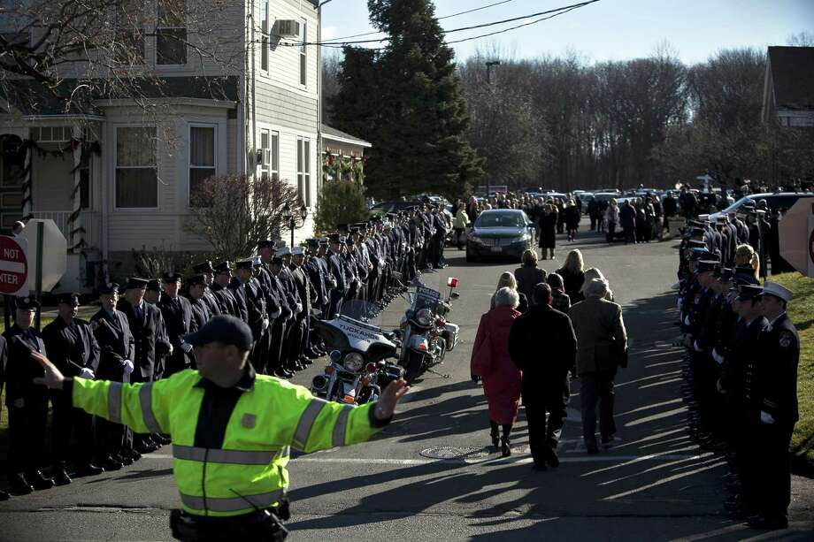 NEWTOWN, CT - DECEMBER 19:  Mourners enter St. Rose of Lima Church for the funeral of Charlotte Bacon, 6, December 19, 2012 in Newtown, Connecticut. Six victims of the Newtown school shooting are being honored at funerals and visitations across the state today for the victims of Sandy Hook Elementary School. Photo: Allison Joyce,  (Photo By Allison Joyce/Getty Images) / 2012 Getty Images