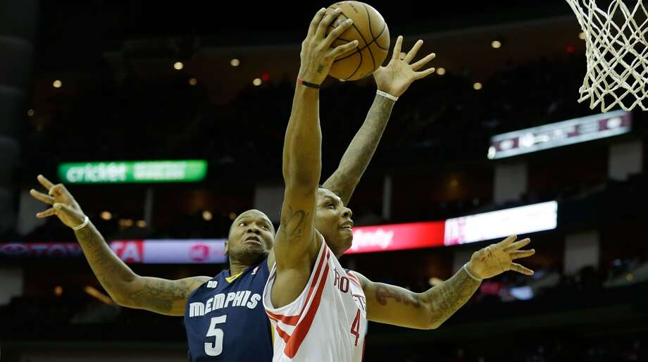 Greg Smith of the Rockets drives against Marreese Speights of the Grizzlies. (Scott Halleran / Getty Images)