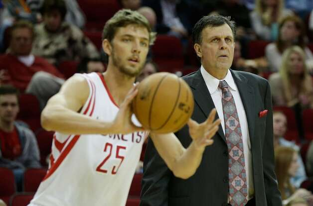 Head coach Kevin McHale of the Rockets looks on as forward Chandler Parsons makes a pass. (Scott Halleran / Getty Images)