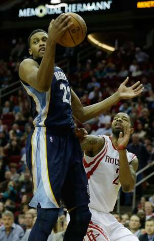 Rudy Gay of the Grizzlies grabs a rebound over Marcus Morris of the Rockets.  (Scott Halleran / Getty Images)