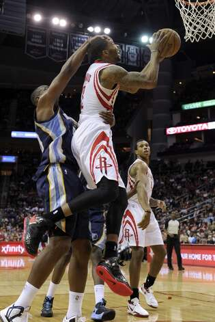 Rockets forward Marcus Morris is fouled by Grizzlies forward Darrell Arthur. (Pat Sullivan / Associated Press)