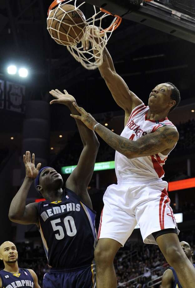 Rockets forward Greg Smith dunks the ball over Grizzlies forward Zach Randolph. (Pat Sullivan / Associated Press)