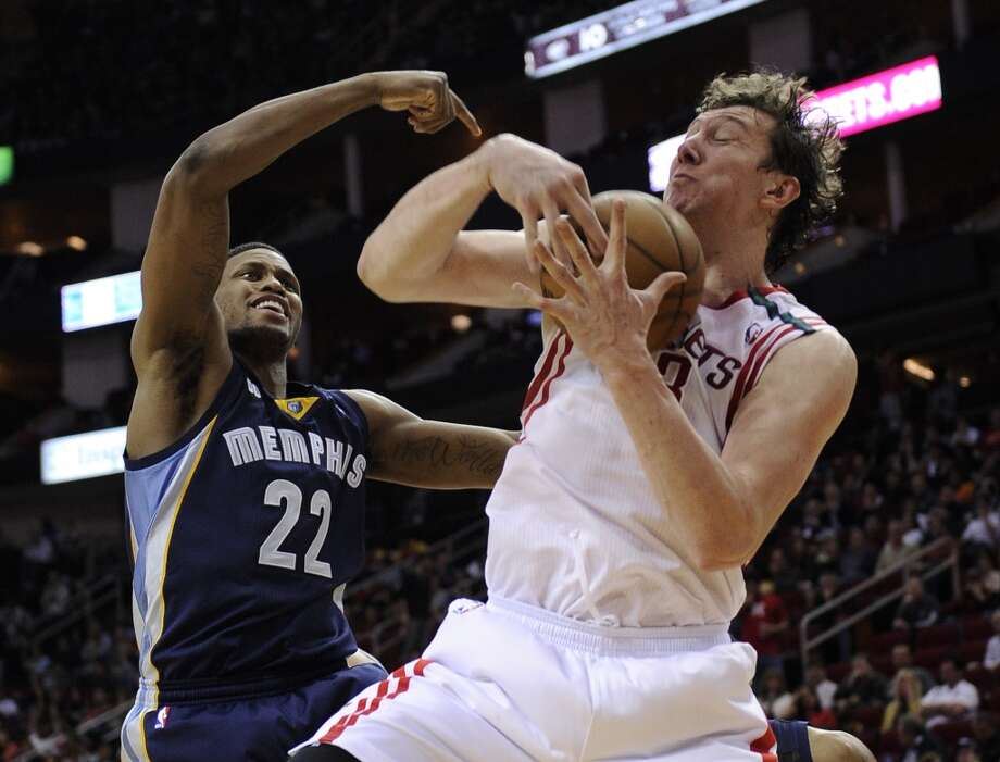Rockets center Omer Asik outrebounds Grizzlies forward Rudy Gay. (Pat Sullivan / Associated Press)