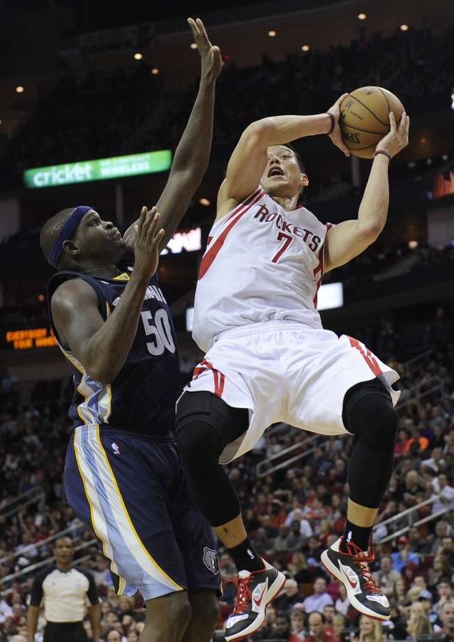 Rockets point guard Jeremy Lin goes to the basket against Grizzlies forward Zach Randolph. (Pat Sullivan / Associated Press)