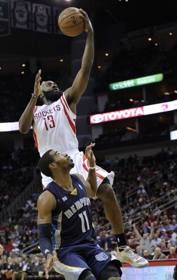 James Harden (13) is fouled by Mike Conley. (Pat Sullivan / Associated Press)