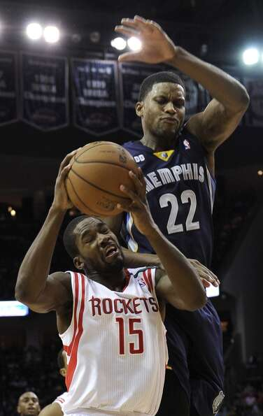 Toney Douglas (15) is fouled by Rudy Gay. (Pat Sullivan / Associated Press)