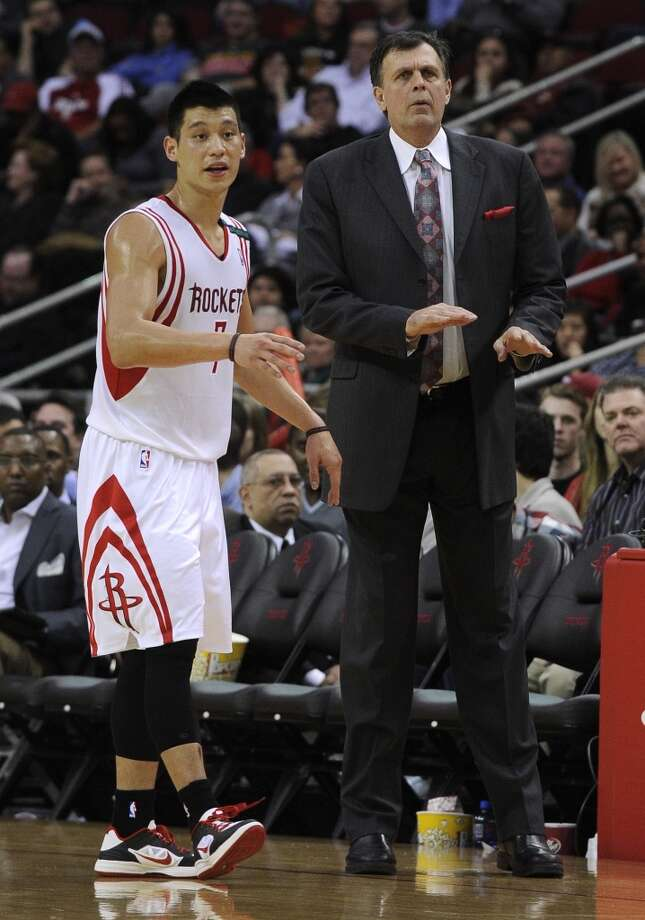 Rockets guard Jeremy Lin talks with coach Kevin McHale. (Pat Sullivan / Associated Press)