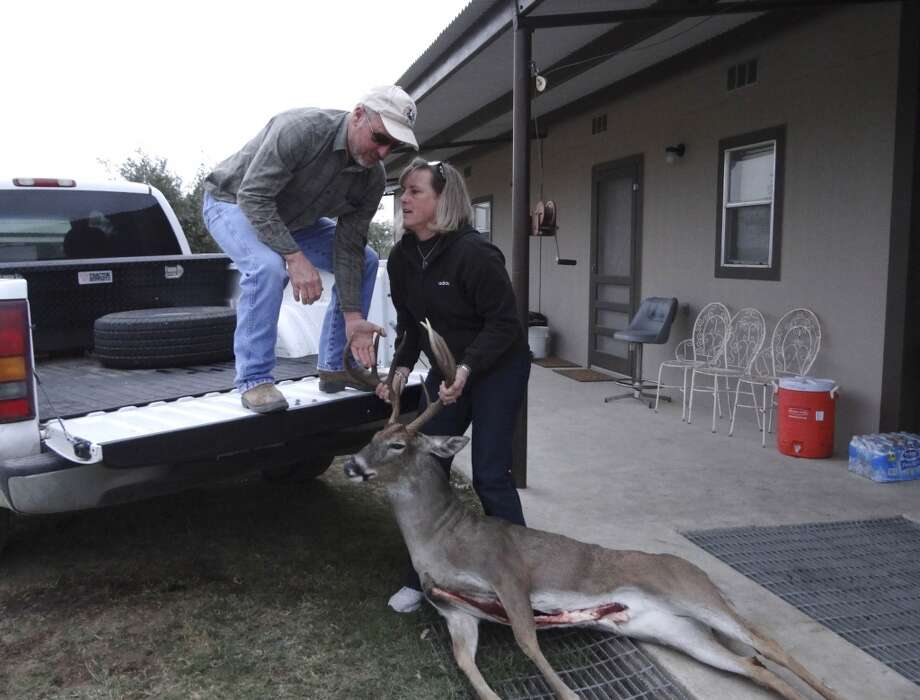 Terry Retzloff helps his wife, Annmarie, load a harvested deer to have it taken to be processed on Friday, Dec. 14, 2012. The Retzloff family offers hunting excursions on their ranch property in South Texas. They have leased several sites on their land for hydraulic fracturing. (San Antonio Express-News)