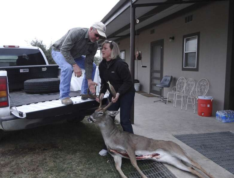 Terry Retzloff helps his wife, Annmarie, load a harvested deer to have it taken to be processed on F