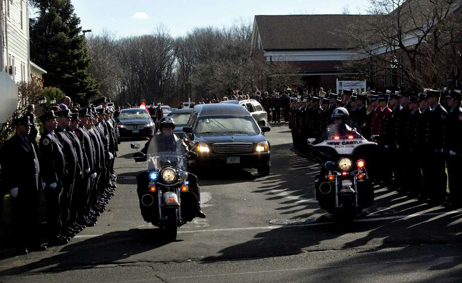 The hearse carrying the casket of Daniel Barden, 7, a victim of the shooting at Sandy Hook Elementary School, leaves St. Rose of Lima Church December 19, 2012 in Newtown, Connecticut. Six victims of the Newtown school shooting are being honored at funerals and visitations across the state today for the victims of Sandy Hook Elementary School. (Photo by Allison Joyce/Getty Images) Photo: Allison Joyce, Getty Images / 2012 Getty Images