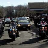 The hearse carrying the casket of Daniel Barden, 7, a victim of the shooting at Sandy Hook Elementary School, leaves St. Rose of Lima Church December 19, 2012 in Newtown, Connecticut. Six victims of the Newtown school shooting are being honored at funerals and visitations across the state today for the victims of Sandy Hook Elementary School. (Photo by Allison Joyce/Getty Images)