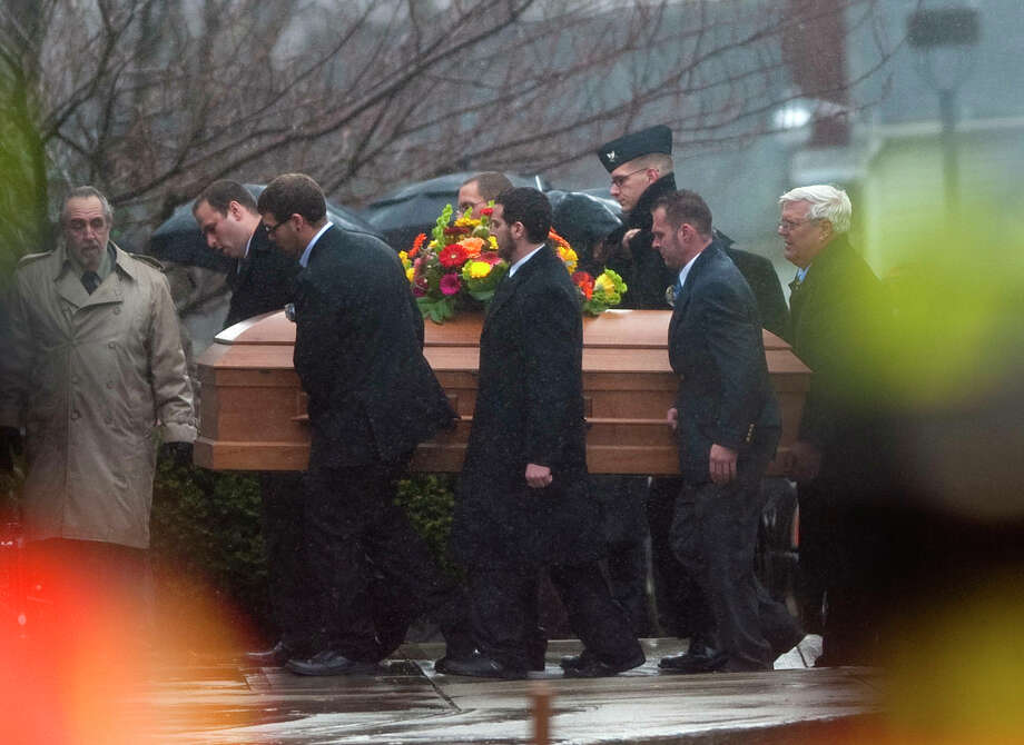 The casket for  Rachel D'Avino is carried into the Church of the Nativity in Bethlehem, Conn., on Friday Dec. 21, 2012.  D'Avino was killed when Adam Lanza walked into Sandy Hook Elementary School in Newtown, Conn., Dec. 14, and opened fire, killing 26 people, including 20 children, before killing himself. Photo: Jim Shannon, (AP Photo/The Republican-American, Jim Shannon)  / Associated Press