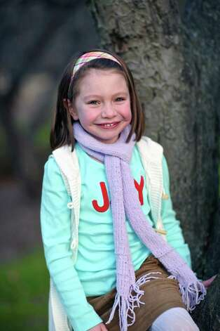 This Nov. 18, 2012 photo provided by John Engel shows Olivia Engel, 6, in Danbury, Conn. Olivia Engel. Olivia Engel, was killed Friday, Dec. 14, 2012, when a gunman opened fire at Sandy Hook Elementary School, in Newtown, Conn., killing 26 children and adults at the school. Photo: Tim Nosezo, (AP Photo/Engel Family, Tim Nosezo) / Associated Press