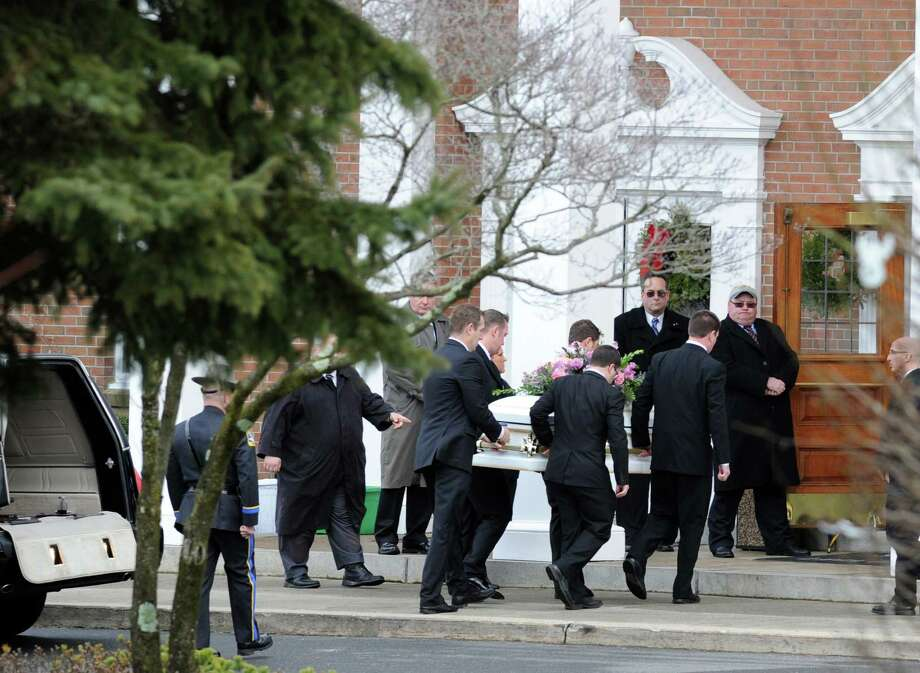 The casket of Sandy Hook Elementary School student Olivia Rose Engel is carried into the St. Rose of Lima Roman Catholic Church during the start of her Funeral Mass in Newtown, Friday afternoon, Dec. 21, 2012. Photo: Bob Luckey / Greenwich Time