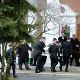 The casket of Sandy Hook Elementary School student Olivia Rose Engel is carried into the St. Rose of Lima Roman Catholic Church during the start of her Funeral Mass in Newtown, Friday afternoon, Dec. 21, 2012.