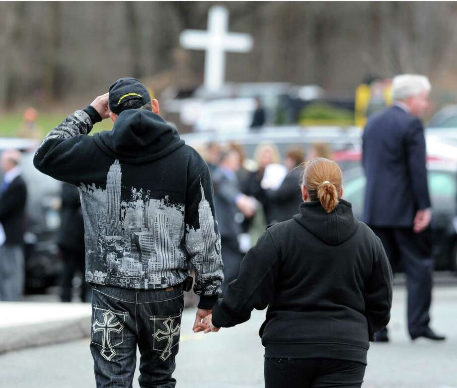 Mourners hold hands at the conclusion of the Funeral Mass for Sandy Hook Elementary School student Olivia Rose Engel at St. Rose of Lima Roman Catholic Church in Newtown, Friday afternoon, Dec. 21, 2012. Photo: Bob Luckey / Greenwich Time