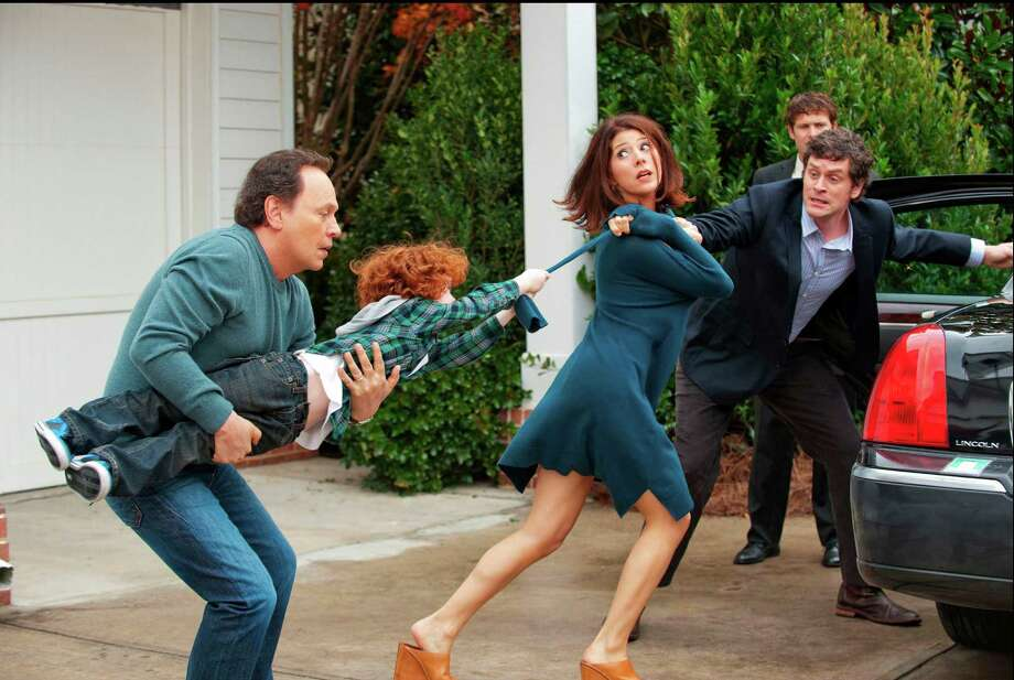 "This undated publicity photo released by Twentieth Century Fox and Walden Media shows Billy Crystal, left, as Artie holding on to his grandson, Kyle Harrison Breitkopf, as Barker, who doesn't like the idea of Marisa Tomei, center, as the mother Alice and Tom Everett Scott as the dad Phil leaving for a vacation in a scene from the film, ""Parental Guidance."" (AP Photo/Twentieth Century Fox/Walden Media, Phil Caruso) Photo: Phil Caruso, Associated Press / Twentieth Century Fox/Walden Med"