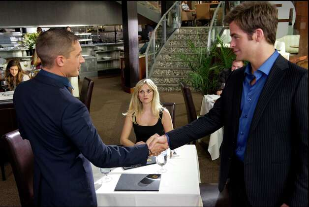 "In ""This Means War,"" two CIA agents, competing for the same woman (Reese Witherspoon), start spying on her with sophisticated surveillance equipment, in between leaving the office to go kill dozens of people, something that doesn't faze them in the slightest. The movie was a missive from a horrible place, a still-fictional but possible future world in which bullying is lovable, brutality is sport and power is free to rampage; in which people are not human but subhuman — smiling, craving veneers without souls. But the creepiest thing about the movie was that no one, either in front or behind the camera, noticed it was creepy. To all concerned, this was just a jolly romantic comedy. Photo: Kimberley French, Associated Press / TM and © 2012 Twentieth Century Fox Film Corporation. All rights reserved. Not for sale or duplication."