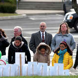 Mourners look at a memorial before the funeral for Josephine Gay at  St. Rose of Lima Roman Catholic Church, Saturday, Dec. 22, 2012, in Newtown. Gay was one of 26 killed after gunman Adam Lanza opened fire killing 26 individuals, 20 whom were children, at Sandy Hook Elementary School last Friday.