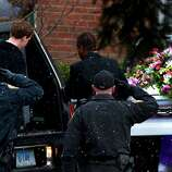 Police salute as the casket of Josephine Gay is loaded into a hearse after her funeral at St. Rose of Lima Roman Catholic Church, Saturday, Dec. 22, 2012, in Newtown. Soll was one of 26 killed after gunman Adam Lanza opened fire killing 26 individuals, 20 whom were children, at Sandy Hook Elementary School last Friday.